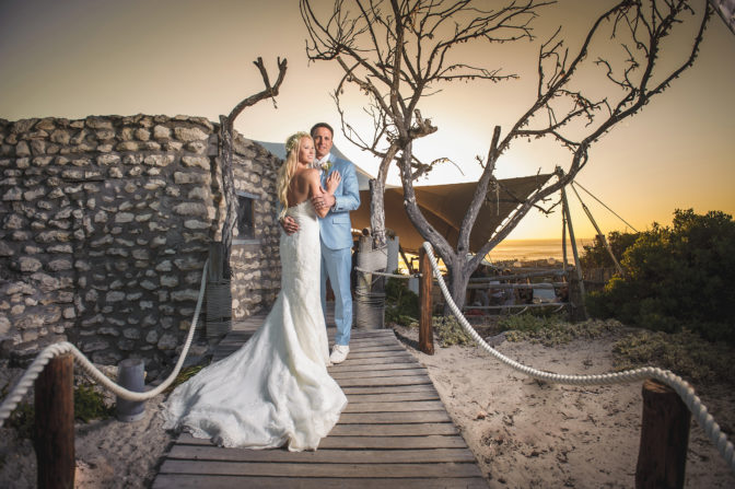 Bride and groom at sunset at beach venue in Yzerfontein