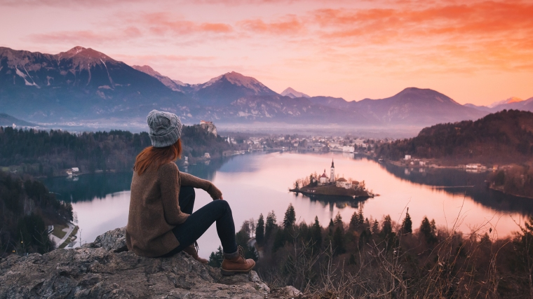 A woman looking at view from Lake Bled